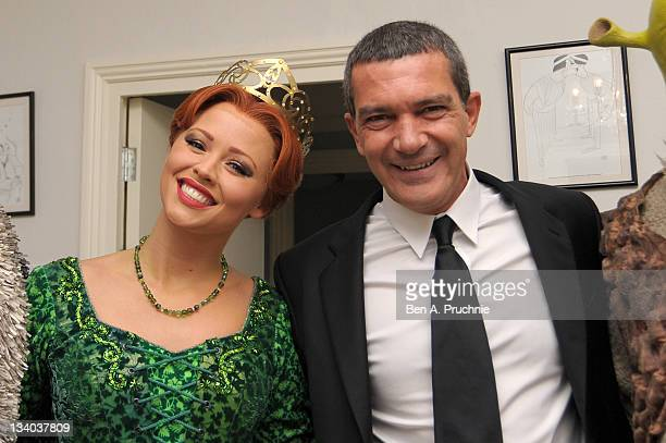 Actor Antonio Banderas poses with cast member of 'Shrek The Musical' Kimberly Walsh at a photocall to promote his new film 'Puss In Boots' at Theatre...