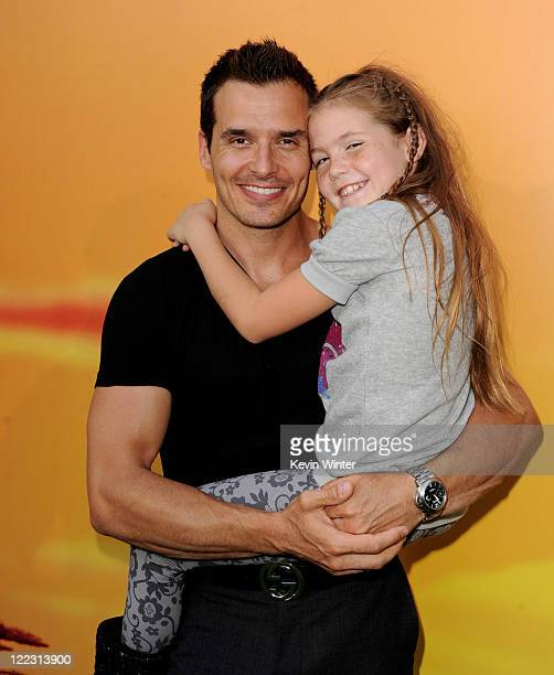 Actor Antonio Sabato Jr and his daughter Mina arrive at the premiere of Walt Disney Studios' 'The Lion King 3D' at the El Capitan Theater on August...