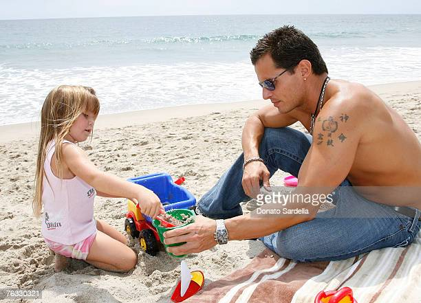 MALIBU CA AUGUST 25 Actor Antonio Sabato with daughter Mina Sabato play on the beach at the French Connection's Kids connection to benefit The Art Of...