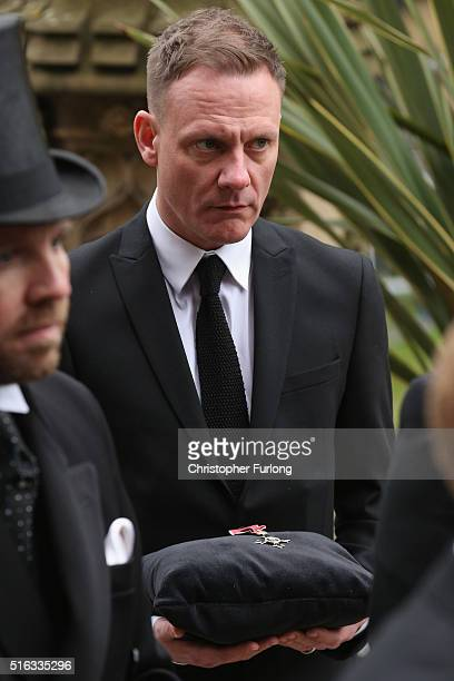 Actor Antony Cotton carries the MBE of Coronation Street scriptwriter Tony Warren at his funeral at Manchester Cathedral on March 18 2016 in...