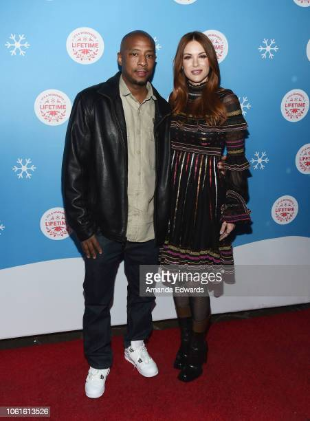 Actor Antwon Tanner and actress Danneel Ackles attend the opening night celebration of the LifeSized Gingerbread House Experience at The Grove with...