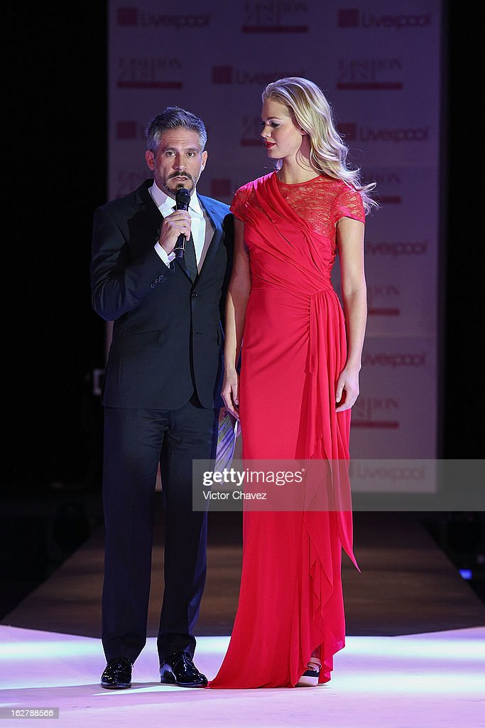 Actor Arath de la Torre interview top model Erin Heatherton during the end of the Liverpool Fashion Fest Spring/Summer 2013 fashion show on February 26, 2013 in Mexico City, Mexico.