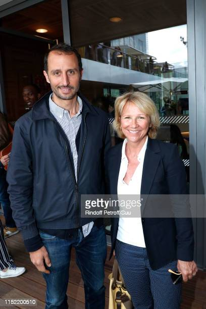 Actor Arie Elmaleh and journalist Ariane Massenet attend the 2019 French Tennis Open - Day Three at Roland Garros on May 28, 2019 in Paris, France.