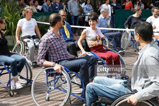 Actor Arie Elmaleh and journalist Erika Moulet attend the Race during the 'All in Wheelchair Day' as part ofthe 2017 French Tennis Open Day Eleven at...