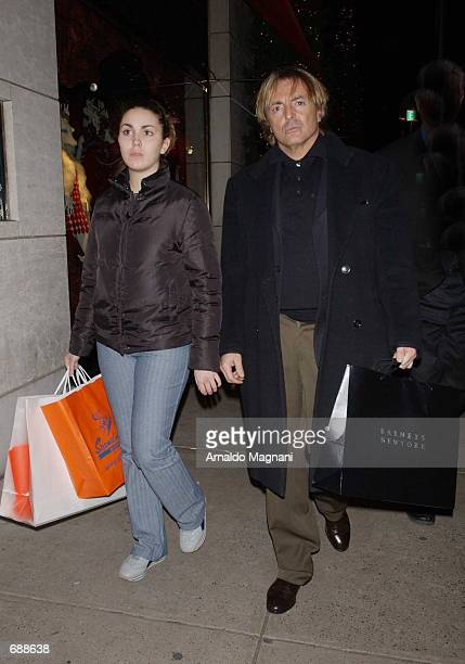 Actor Armand Asante walks with his daughter Ania after shopping at Barneys December 20 2001 in New York City Asante was difficult to recognize...