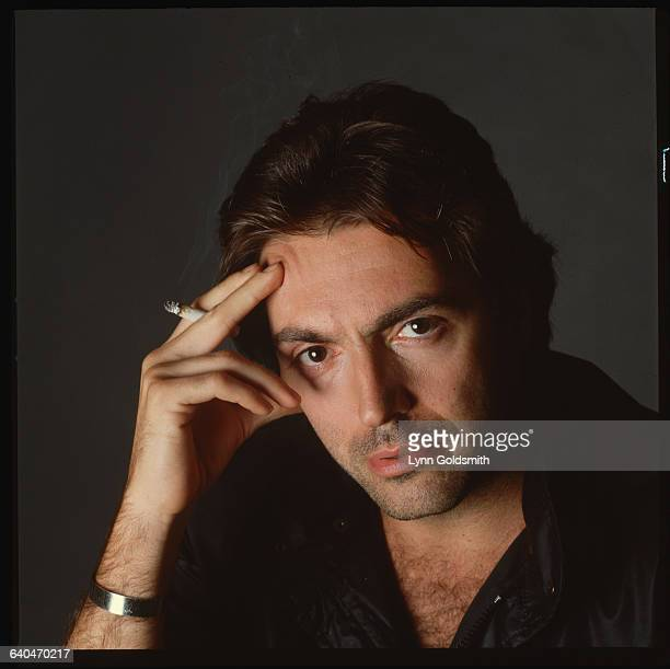 Actor Armand Assante Holding Cigarette