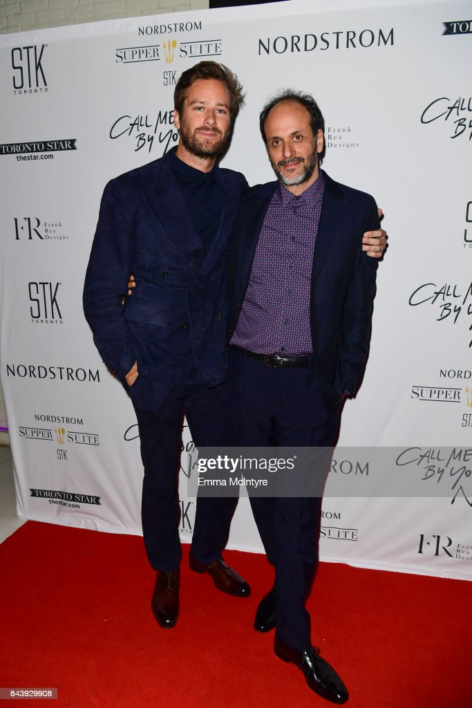 Actor Armie Hammer (L) and director Luca Guadagnino arrive at Nordstrom Supper Suite 'Call Me By Your Name' official premiere after party at STK Toronto on September 7, 2017 in Toronto, Canada.