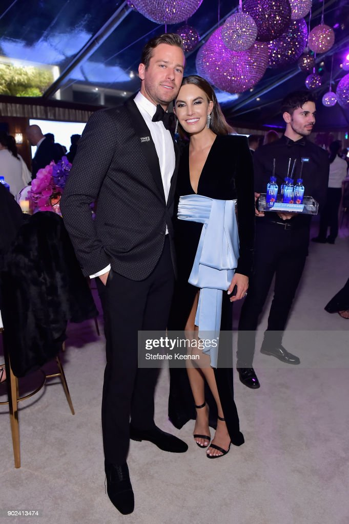 Actor Armie Hammer (L) and Elizabeth Chambers attend FIJI Water at HFPA's Official Viewing and After-Party at the Wilshire Garden inside The Beverly Hilton on January 7, 2018 in Beverly Hills, California.
