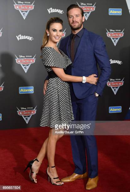 Actor Armie Hammer and wife Elizabeth Chambers Hammer arrive at the premiere of 'Cars 3' at Anaheim Convention Center on June 10 2017 in Anaheim...