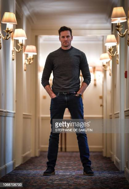 US actor Armie Hammer poses on December 4 2018 at the Bristol palace hotel in Paris