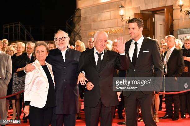 Actor Armin MuellerStahl and his wife Gabriele Scholz are greeted by the directors Juergen Flimm and Matthias Schulz at the reopening of the Berliner...
