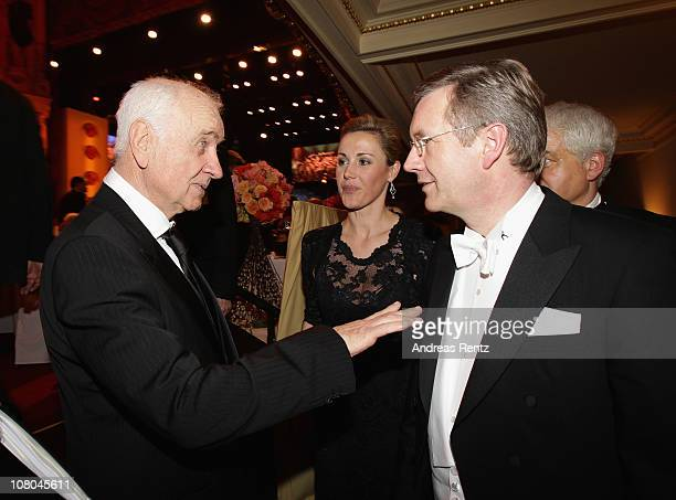Actor Armin Mueller-Stahl chats with German President Christian Wulff and German First Lady Bettina Wulff during the Semper Opera ball on January 14,...