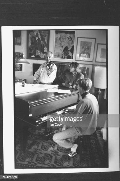 Actor Armin MuellerStahl playing his violin w his son Christian playing the piano as his wife Gabriele watches
