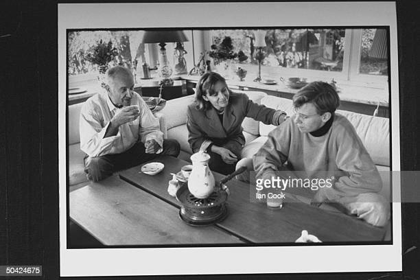 Actor Armin MuellerStahl w his wife Gabriele and son Christian in living room drinking coffee