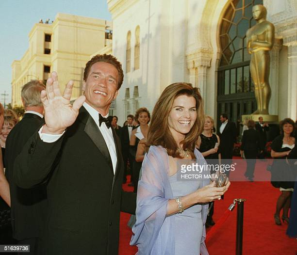 Actor Arnold Schwarzenegger and his wife reporter Maria Shriver arrive for the 70th Annual Academy Awards 23 March in Los Angeles CA AFP PHOTO/Hector...