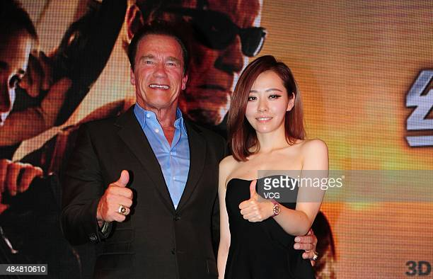 Actor Arnold Schwarzenegger and singer Jane Zhang attend a press conference of Alan Taylor's film 'Terminator Genisys' on August 21 2015 in Shanghai...