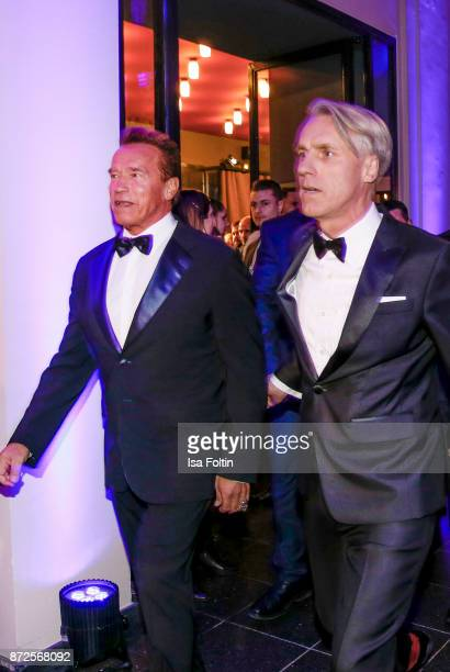 US actor Arnold Schwarzenegger and Tom Junkersdorf chief editor GQ magazine Germany arrive for the GQ Men of the year Award 2017 at Komische Oper on...