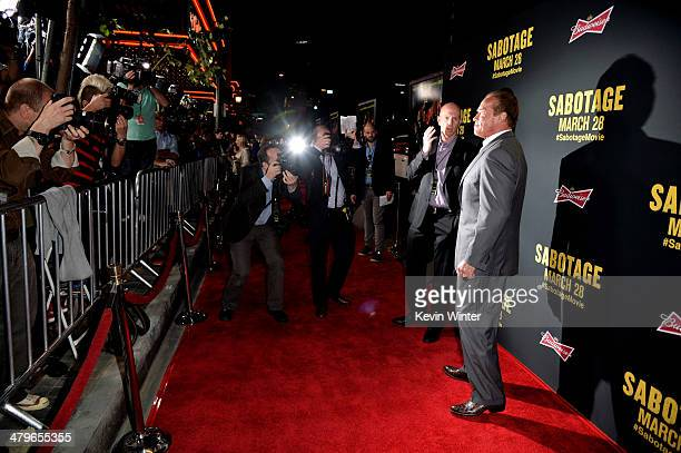 """Actor Arnold Schwarzenegger arrives at the premiere of Open Road Films' """"Sabotage"""" at the Regal Cinemas L.A. Live on March 19, 2014 in Los Angeles,..."""