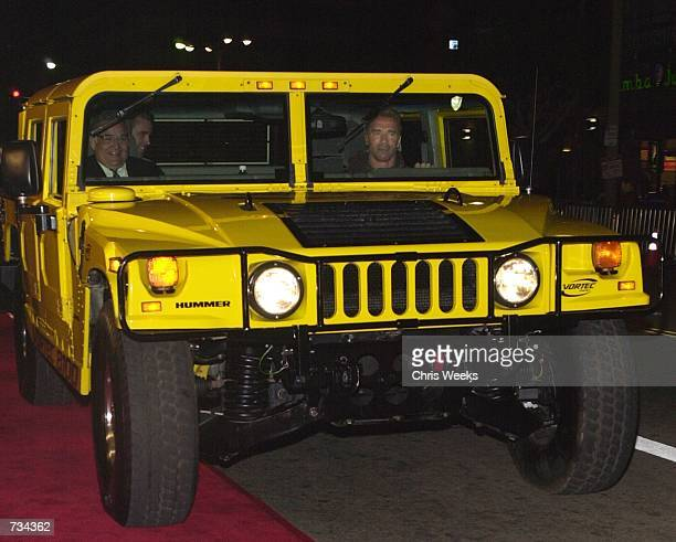 Actor Arnold Schwarzenegger arrives at the premiere of The Sixth Day in his hummer November 13 2000 in Westwood CA
