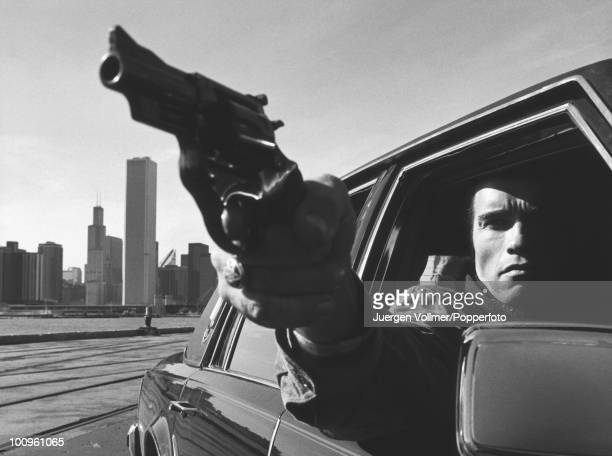 Actor Arnold Schwarzenegger films a scene for the film 'Raw Deal' in Chicago 1986