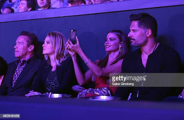 Actor Arnold Schwarzenegger physical therapist Heather Milligan actress Sofia Vergara and actor Joe Manganiello attend the New Year's Eve performance...