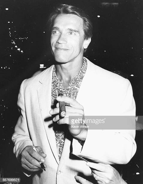 Actor Arnold Schwarzenegger smoking a cigar at Milton Berle's birthday party at La Cage aux Folles restaurant in Los Angeles July 12th 1988