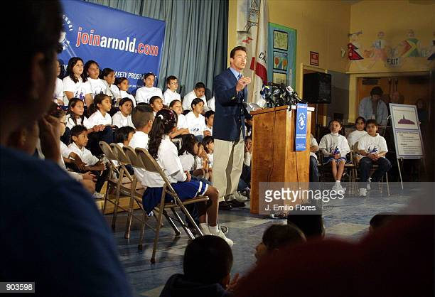 Actor Arnold Schwarzenegger speaks at Hart Street Elementary School during a press conference to launch a statewide campaign for an initiative to...