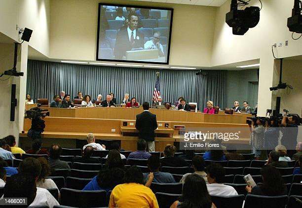 Actor Arnold Schwarzenegger speaks to members of the Los Angeles Unified School District board October 8, 2002 in Los Angeles, California....