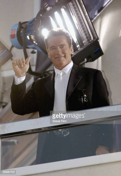 Actor Arnold Schwarzenegger star of the new film Terminator 3 Rise of the Machines waves from a balcony at the Noga Hilton Hotel after attending the...