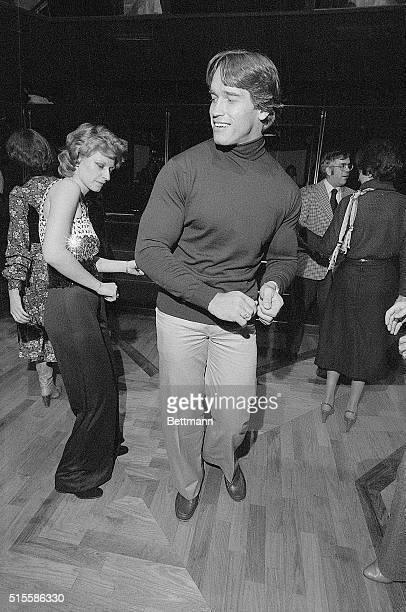 Actor Arnold Schwarzenegger, the Austrian-born former Mr. Universe, dances at a New York disco with Anna Ujvari.