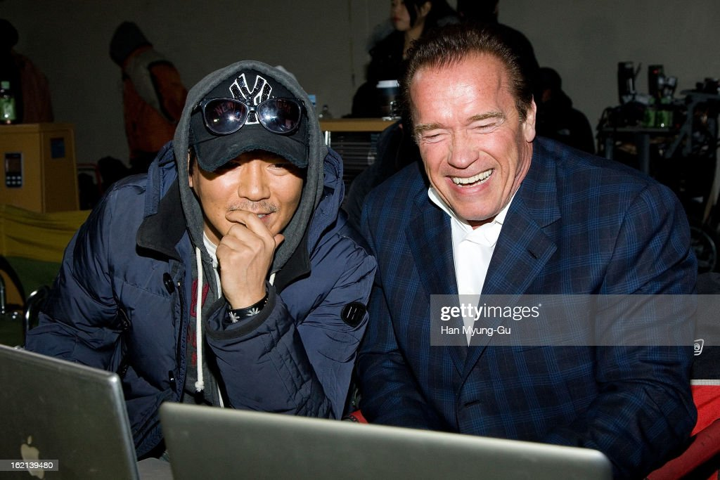 Actor Arnold Schwarzenegger (R) visits director Kim Jee-Woon at the set of his short film 'Hide and Seek' on February 19, 2013 in Hwaseong, South Korea. Arnold Schwarzenegger is visiting South Korea to promote his recent film 'The Last Stand' which will be released in South Korea on February 21.