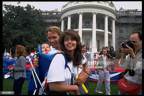 Actor Arnold Schwarzenegger w wife Maria Shriver daughter Katherine Eunice on WH lawn for Great American Workout