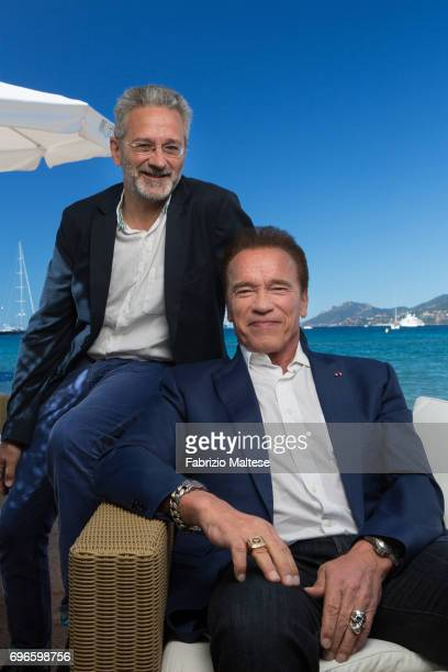 Actor Arnold Schwarzenegger with film producer Francois Mantello are photographed for the Hollywood Reporter on May 20 2017 in Cannes France