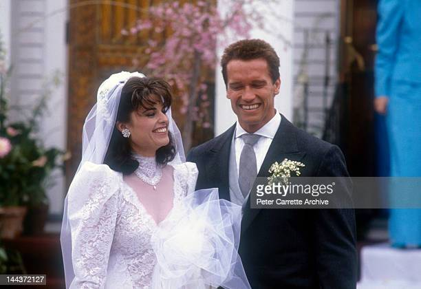Actor Arnold Schwarzenegger with his new wife Maria Shriver outside St. Francis Xavier Church after their wedding on April 26, 1986 in Hyannis,...
