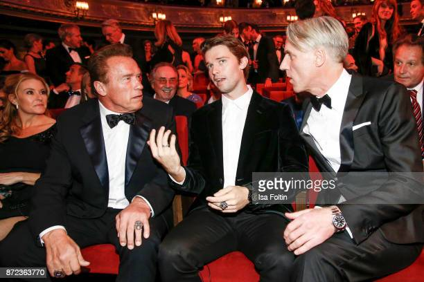 US actor Arnold Schwarzenegger with his son Patrick Schwarzenegger and Tom Junkersdorf chief editor GQ magazine Germany during the GQ Men of the year...