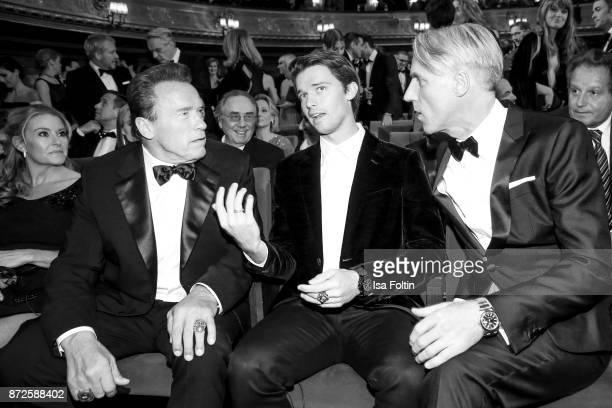 Actor Arnold Schwarzenegger with his son Patrick Schwarzenegger and Tom Junkersdorf, chief editor GQ magazine Germany during the GQ Men of the year...