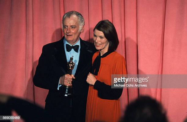 Actor Art Carney poses with actress Glenda Jackson backstage after winning Best Actor award during the 47th Academy Awards at Dorothy Chandler...