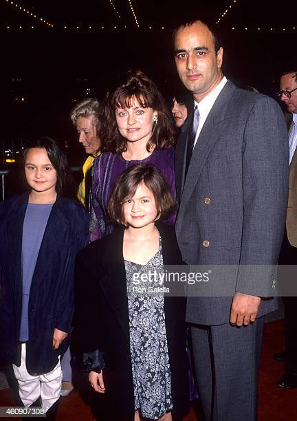 Actor Art Malik wife actress Gina Rowe and daughters Keira and Jessica attend the City of Joy Century City Premiere on April 7 1992 at the Cineplex...