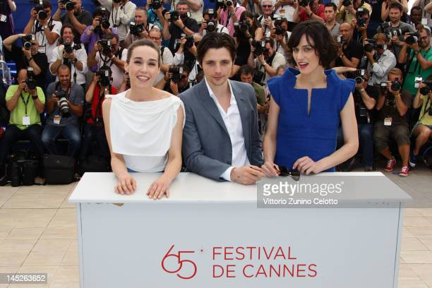 Actor Arta Dobroshi Raphael Personnaz and Clotilde Hesme pose at the Trois Mondes photocall during the 65th Annual Cannes Film Festival at Palais des...