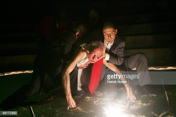 Actor Arthur Dignam and John Leary perform during a photo call for William Shakespeare's Julius Caesar at the Wharf1 Theatre on June 30 2005 in...