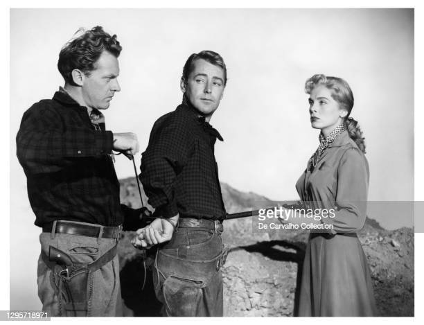 Actor Arthur Kennedy as 'Lane Waldron', Actor Alan Ladd as 'Captain Brett Sherwood' and Actress Lizabeth Scott as 'Chris' in a scene from the movie...