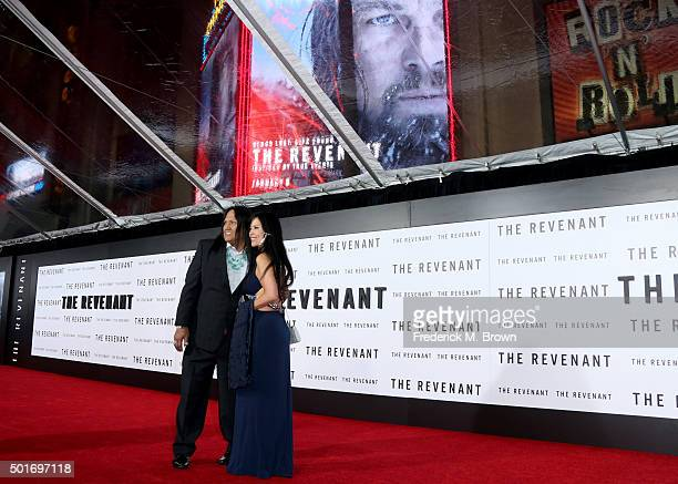 Actor Arthur Redcloud and guest attend the premiere of 20th Century Fox and Regency Enterprises' The Revenant at the TCL Chinese Theatre on December...