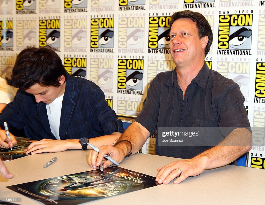 Actor Asa Butterfield (L) and director Gavin Hood speak onstage at the 'Ender's Game' press conference during Comic-Con International 2013 at San Diego Convention Center on July 18, 2013 in San Diego, California.
