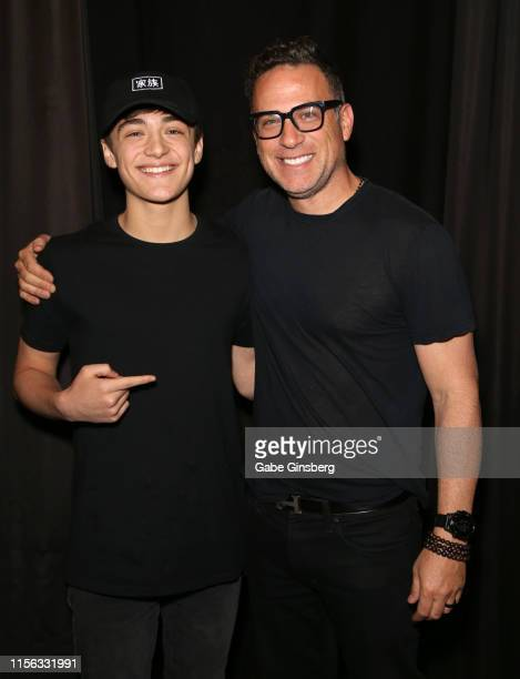 Actor Asher Angel and his father Jody Angel pose backstage after the Shazam Behind the Scenes panel during the Seventh Annual Amazing Las Vegas Comic...