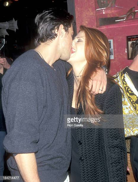 Actor Ashley Hamilton and Actress Angie Everhart attend the Unveiling of Benetton's New Unisex Fragrances Hot and Cold on April 3 1997 at Fashion...