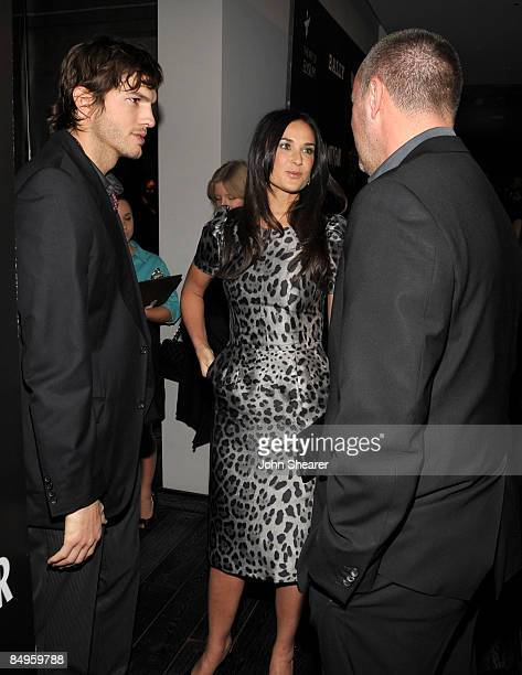 Actor Ashton Kutcher, actress Demi Moore and Vanity Fair publisher Edward Menicheschi arrive at the Bally and Vanity Fair Hollywood Domino Game Night...