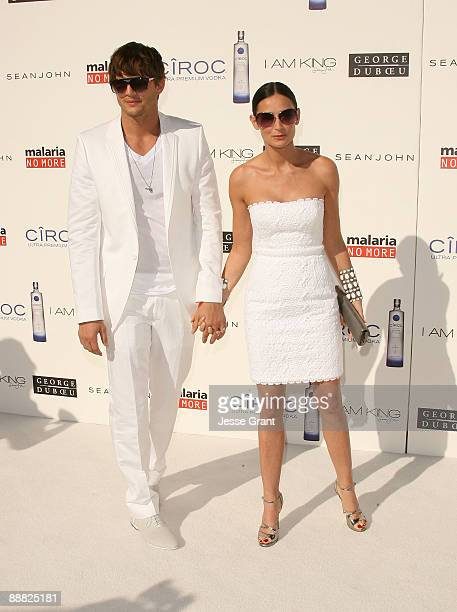 Actor Ashton Kutcher and actress Demi Moore arrive at the White Party hosted by Sean Diddy Combs and Ashton Kutcher to help raise awareness for...