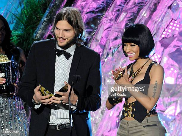 Actor Ashton Kutcher and singer Nicki Minaj speak onstage during the 2011 MTV Movie Awards at Universal Studios' Gibson Amphitheatre on June 5 2011...