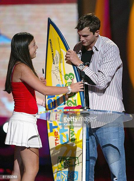 Actor Ashton Kutcher gives his past award to a fan on stage at The 2004 Teen Choice Awards held on August 8 2004 at Universal Amphitheater in...
