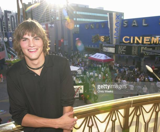 Actor Ashton Kutcher of That 70's Show poses for a photographer August 26 2000 at Rock the Vote part of the National Election 2000 Bus Tour at...